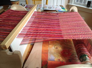 The warp threads, separated by the magical heddle action